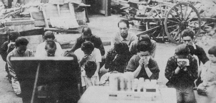 1024px-Japanese_civilians_listening_to_the_surrender_broadcast