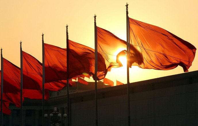 red flags at sunrise
