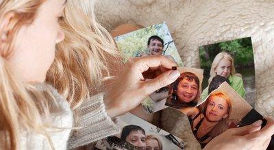 Sad woman, tearing a family photo