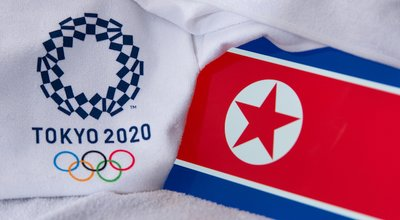 TOKYO, JAPAN, FEBRUARY. 4, 2020: North Korea National flag, official logo of summer olympic games in Tokyo 2020. White background