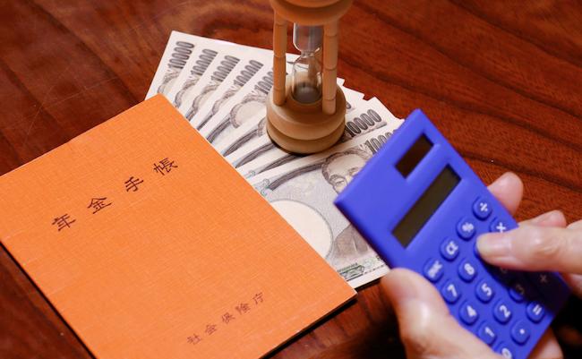 An,Orange,Notebook,And,Elderly,Hands.,Translation:,Pension,Notebook.