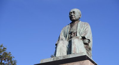 The statue of Shibusawa Eiichi in front of Fukaya station in Fukaya city, Saitama, Japan. December 13, 2020