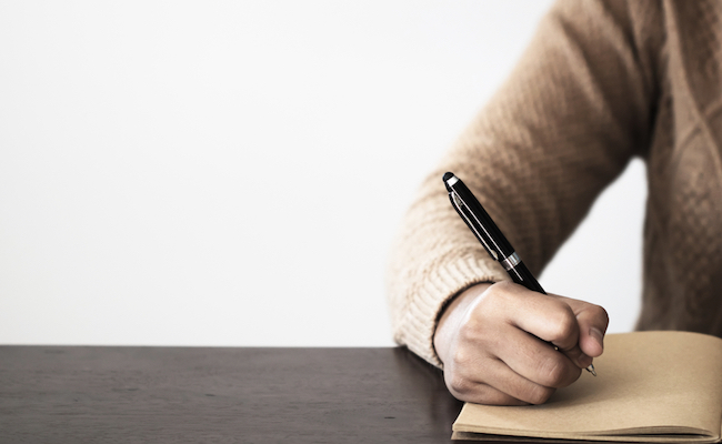 Close,Up,Of,Hand,Holding,Pen,,It's,Like,A,Letter