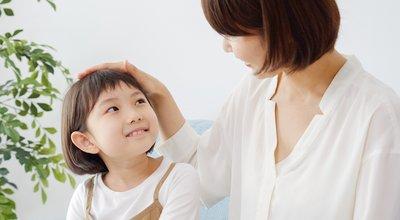 Asian,Family,In,Living,Room