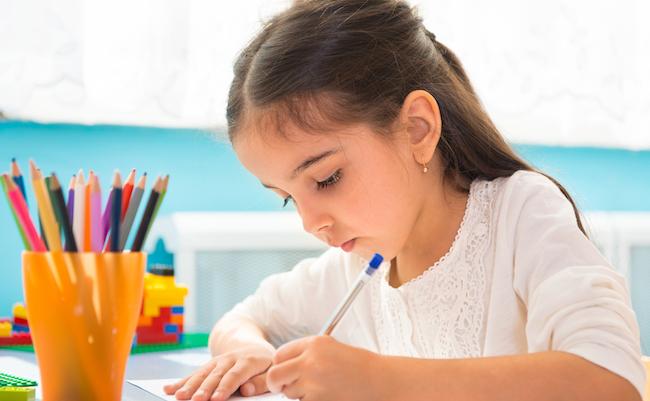 Cute,Little,Hispanic,Girl,Writing,At,School