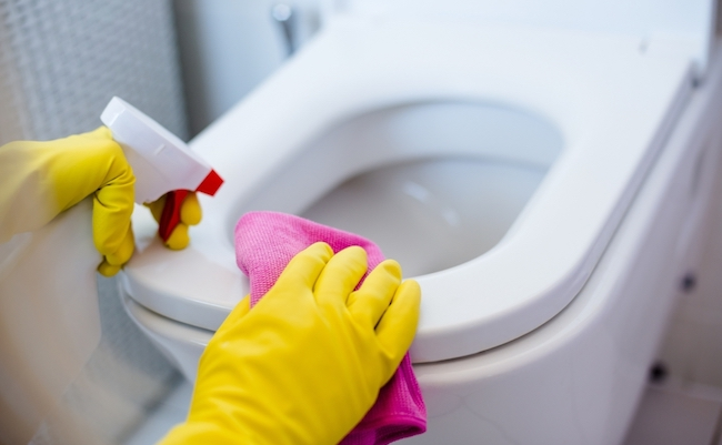 Woman,In,Yellow,Rubber,Gloves,Cleaning,Toilet,With,Pink,Cloth