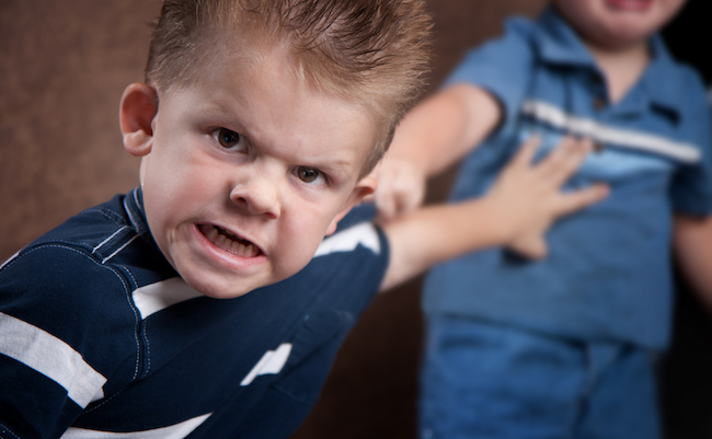 Angry,Little,Boy,Glaring,At,The,Camera,,Fighting,With,His