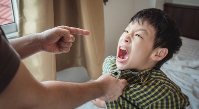 Young,Aggressive,Boy,Yell,To,His,Father,After,Punishment