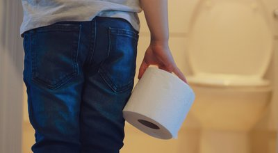 Rare,View,Of,Kid,Holding,Toilet,Roll,In,The,Front