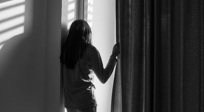 Lonely,Woman,With,Beautiful,Light,In,Room