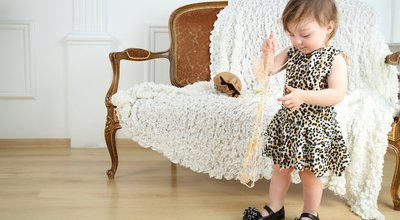 Beautiful,Little,Girl,In,Leopard,Print,Dress,With,Beads,Stands