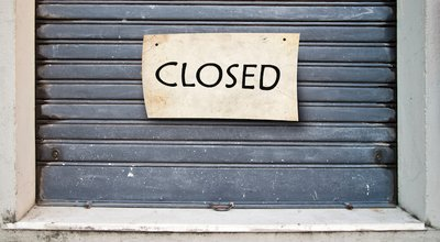 Sad,Lowered,Shutter,Of,A,Closed,Company