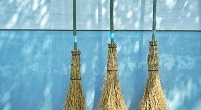 Bamboo,Broom,Hang,On,A,Blue,Wall