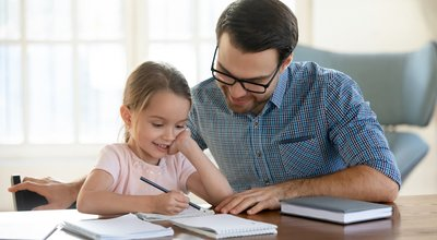 Young,Father,In,Eyeglasses,Pleased,To,See,Little,Daughters',Study