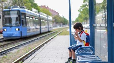 Little,Backpack,Boy,Eating,Food,At,Cable,Car,Station,Alone