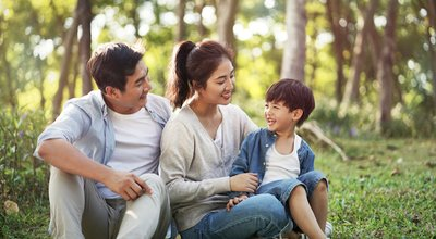 Young,Asian,Parents,And,Son,Having,Fun,Outdoors,In,Park