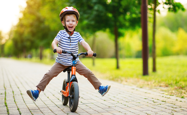 Happy,Child,Boy,Rides,A,Racetrack,In,Park,In,The