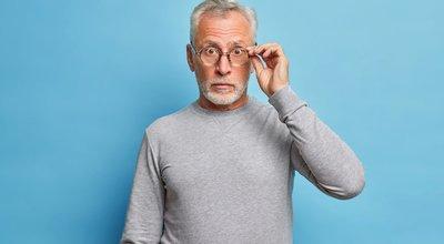 Surprised,Senior,Bearded,Caucasian,Man,Stares,Through,Eyeglasses,Expresses,Shock